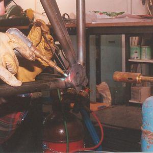 Gas welding engine mount spool