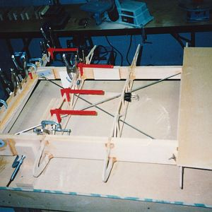 Gluing_in_cap_strip_for_plywood_wing_walk_support.jpg