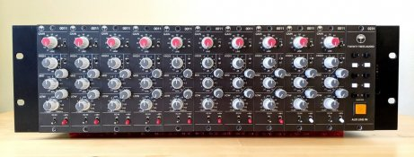 A black 500 series rack, 3U high, containing ten Helios type 69 style input modules. Each module is a discrete transistor mic preamp, with a passive equaliser. There is an additional module to the far right, with a bank of buttons.