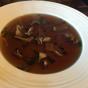 Beef consume with maitake and scallions